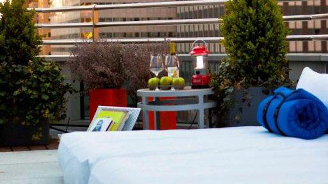 "PHOTO: Beds, snacks and wine service are set up on room terraces as part of Hyatt 48 Lex's ""Suite Glamping"" program."