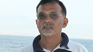 Sanjeev Midha has one of the country?s largest passports. Here he is in Greece.