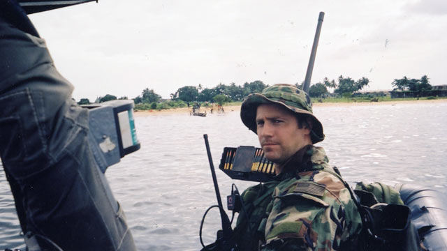 "PHOTO: Lt. Denver in Monrovia Harbor, Liberia, 2003."" Photograph courtesy of the author. From ""Damn Few: Making the Modern SEAL Warrior"" Copyright 2013 Rorke Denver"