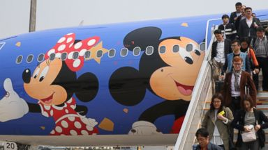 PHOTO: Passengers exit a Disney-themed plane from China Eastern Airlines in Beijing, April 26, 2016.
