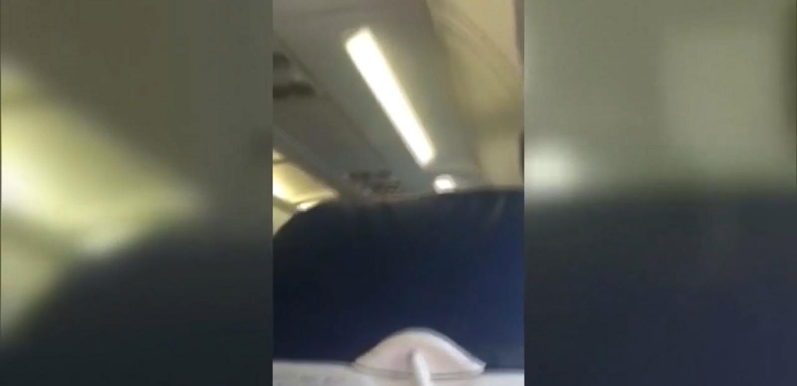 VIDEO: The passenger was removed after reportedly not hearing a flight attendant's directions to move out of the aisle.