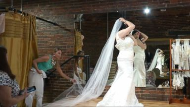 ' ' from the web at 'http://a.abcnews.go.com/images/US/151111_kcrg_wedding_dress_veterans1_16x9t_384.jpg'
