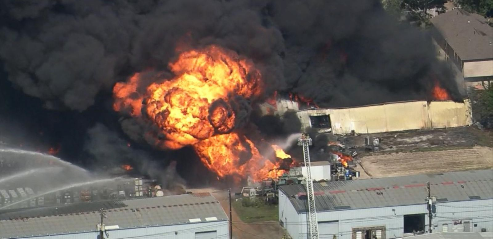 A 4-alarm fire at a business in west Houston sent flames and heavy black smoke into the air.