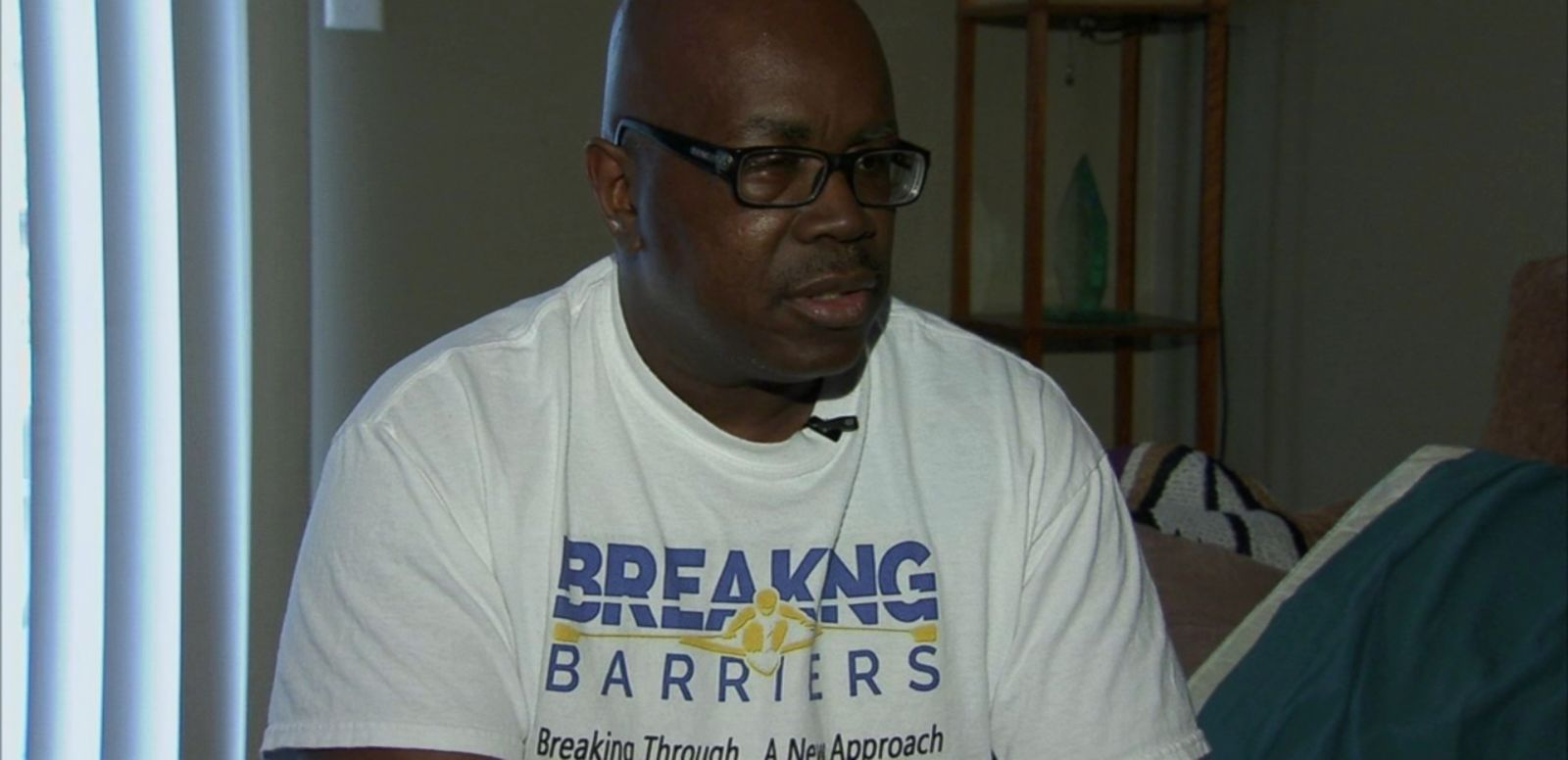 VIDEO: Dwayne Adams was caught in the crossfire of bullets while sitting on his mother's porch in 1998.