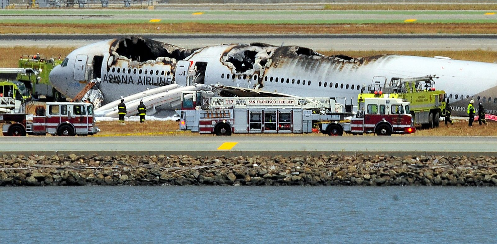 PHOTO: An Asiana Airlines Boeing 777 is seen on the runway at San Francisco International Airport after crash landing, July 6, 2013.