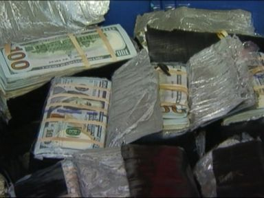 PHOTO: About $600,000 in cash stolen from a million-dollar heist over a year ago was discovered buried in the backyard of a home in Fontana, Calif., Oct. 7, 2015.