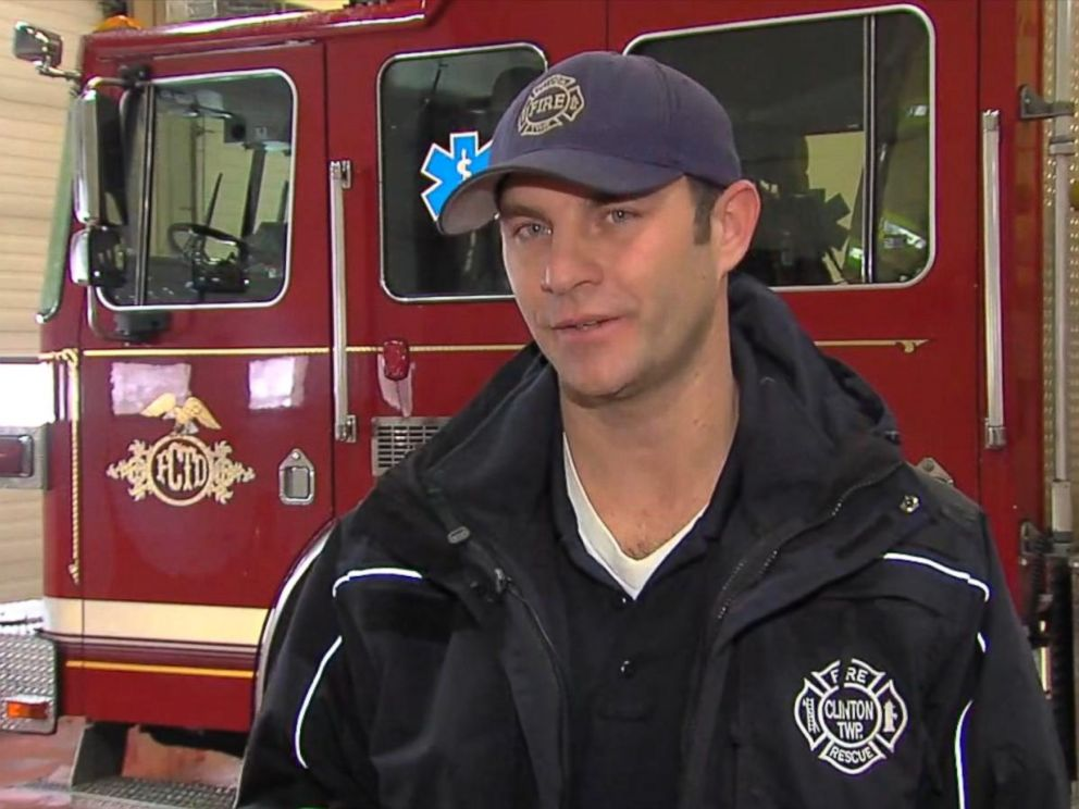 PHOTO: Firefighter Ryan McCuen from the Clinton Township, Mich. Fire Department paid the electric bill for the Stone family after their power had been shut off for failure to pay the bill.