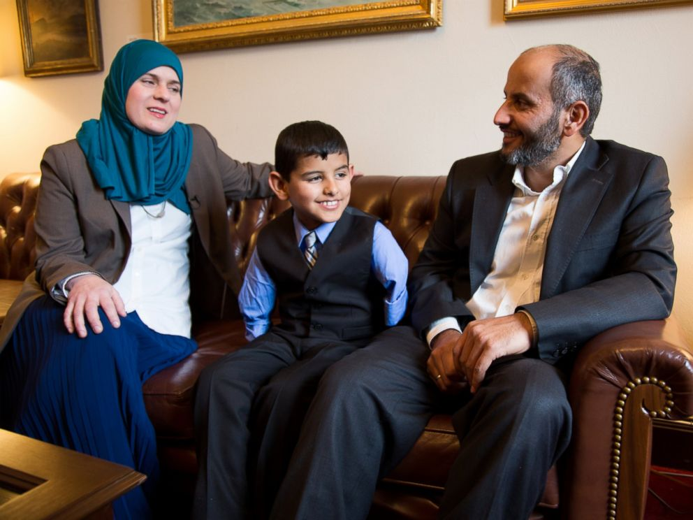 PHOTO: Ahmad Alkhalaf, 9, sits with his father and Nadia Alawa, executive director at NuDay Syria, left.