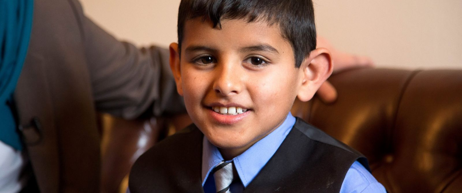 PHOTO: Nine-year old Ahmad Alkhalaf lost both of his arms after an airstrike hit his Syrian refugee camp. He is Congressman Seth Moultons guest for the State of the Union.