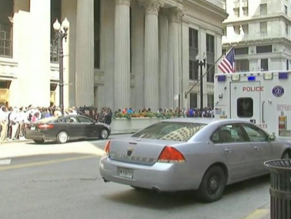 PHOTO: Police vehicles are parked outside of 231 South Lasalle St. in Chicago following a shooting inside the building.