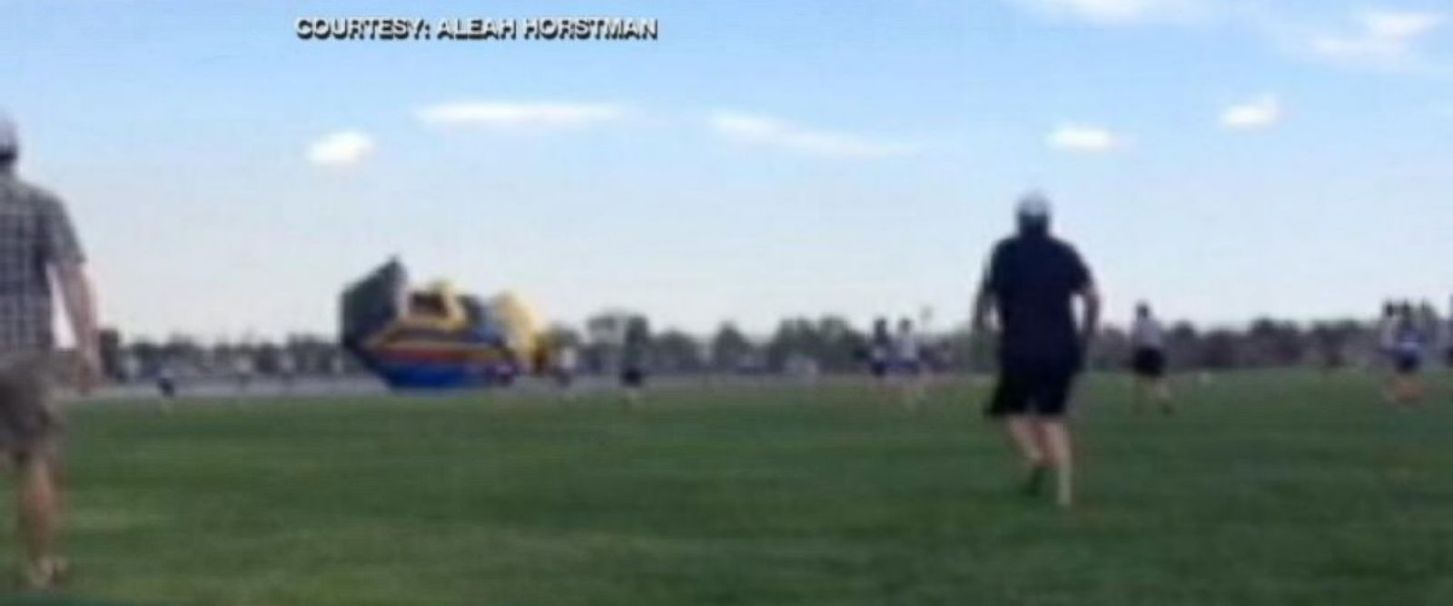 PHOTO: Bounce house goes airborne with two children inside.