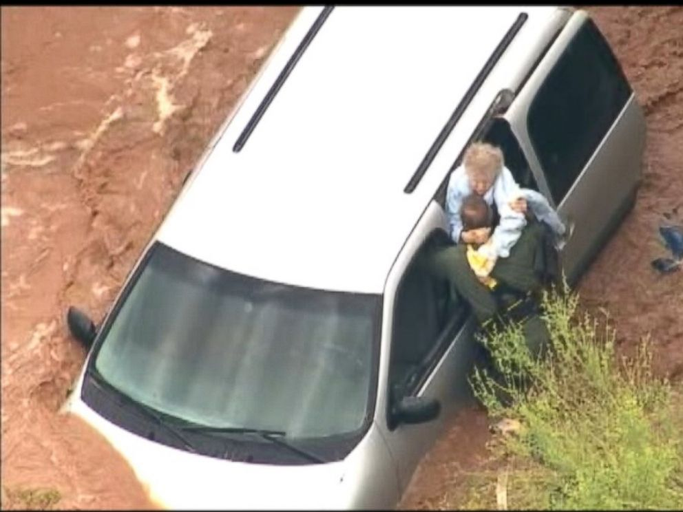 PHOTO: MCSO crews rescue a woman trapped in flood waters.