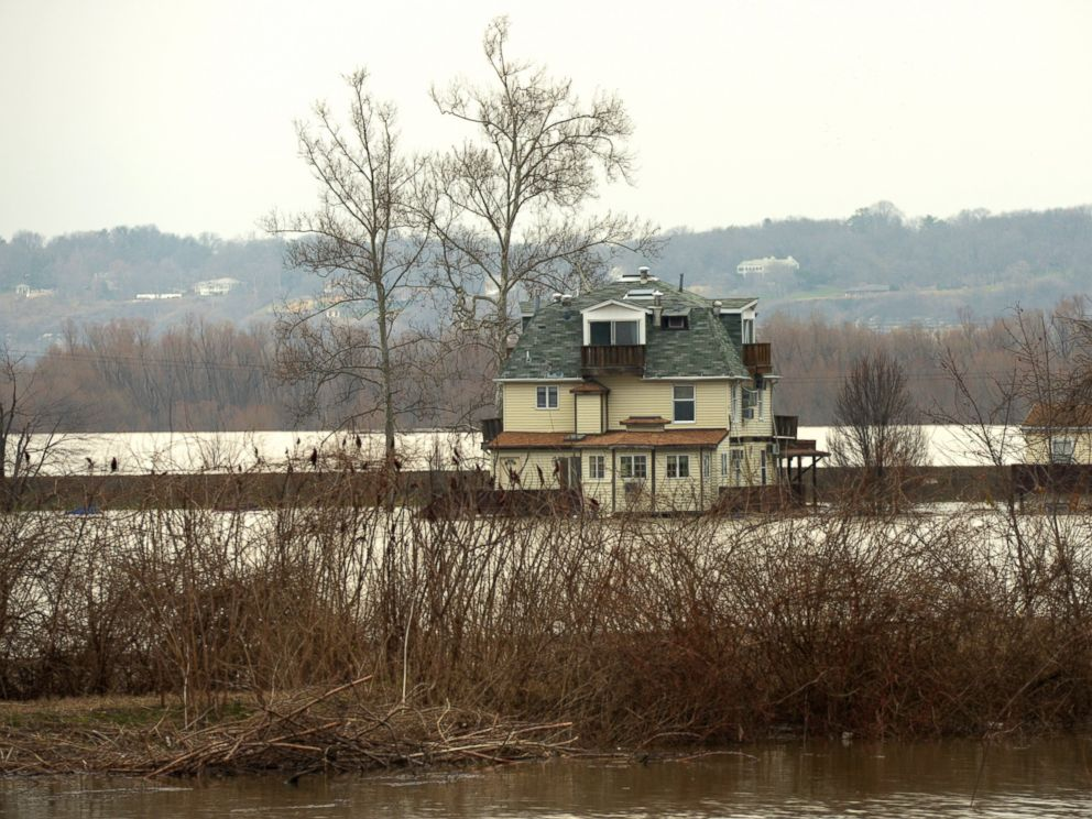 PHOTO: Farmland adjacent to Highway 67 in West Alton remains flooded on Wednesday, Dec. 30, 2015. Residents of West Alton, Mo. evacuated as climbing water threatened exit routes.