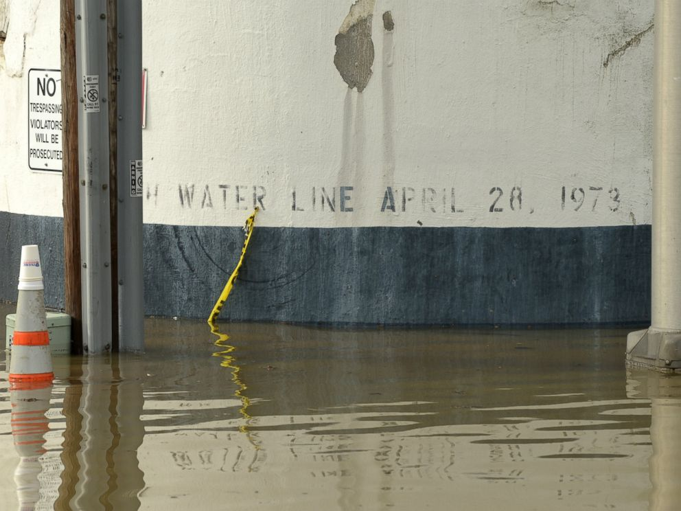 PHOTO: Flood water near the Ardent Mills get close to historic flood level of 1973. The black band on the silo wall indicates the level of water during the April 28, 1973 floods.