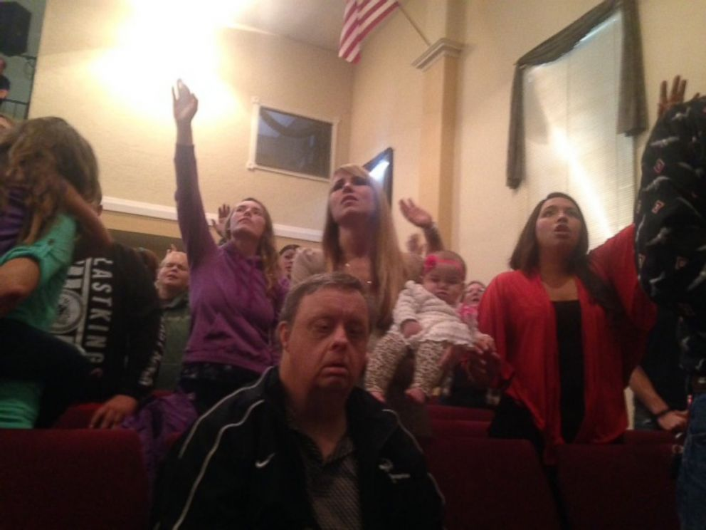 PHOTO: Members of the congregation at New Beginnings Church of God in Roseburg, Oregon, sing Sunday, October 4, 2015, after Pastor Randy Scroggins sermon about the recent community college shooting that left 10 people dead.