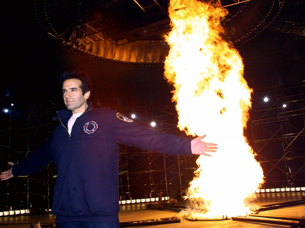PHOTO: Illusionist David Copperfield stands in front of his Tornado of Fire Wednesday, March 28, 2001, in an empty pier in New York.