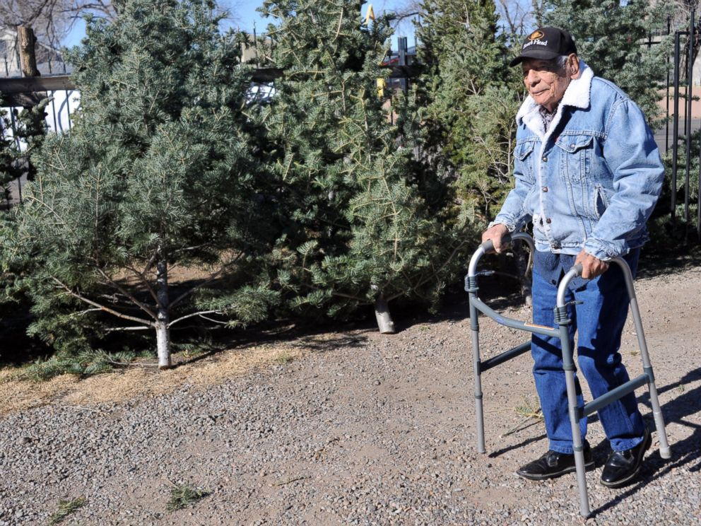 PHOTO: In this Dec. 9, 2011 file photo, Tony Garcia, 99, sells Christmas trees from his front yard on 4th Street, north of Paseo del Norte in Albuquerque, N.M.