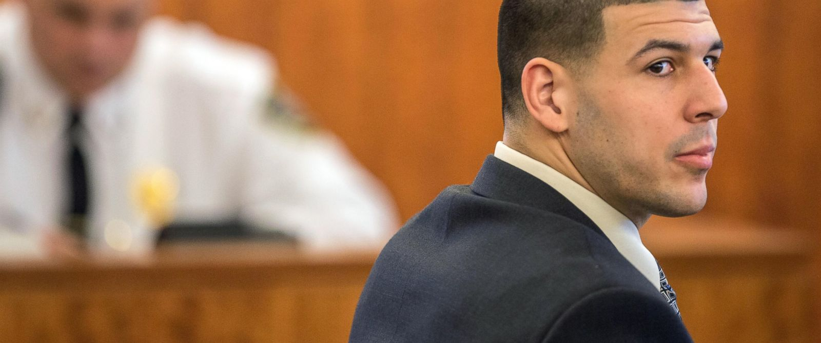 PHOTO: Former New England Patriots football player Aaron Hernandez looks towards the jury during his murder trial at Bristol County Superior Court in Fall River, Mass., Feb. 25, 2015.
