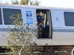 PHOTO: A BART police officer looks out of a BART car that struck and killed two people