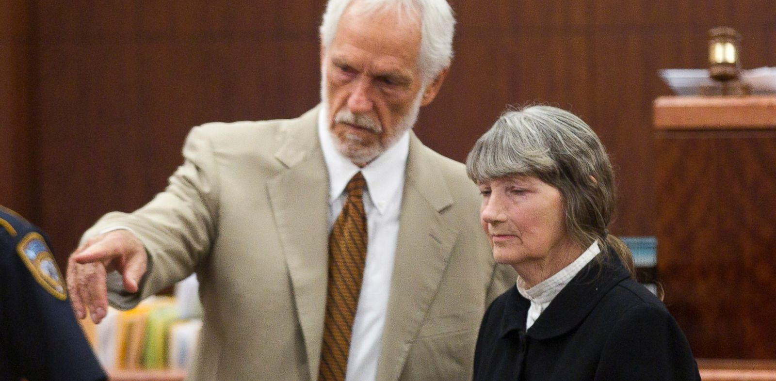 PHOTO: Attorney James Stafford, left, shows Carolyn Krizan-Wilson, right, to her seat as she appears in court, Oct. 23, 2013, in Houston.
