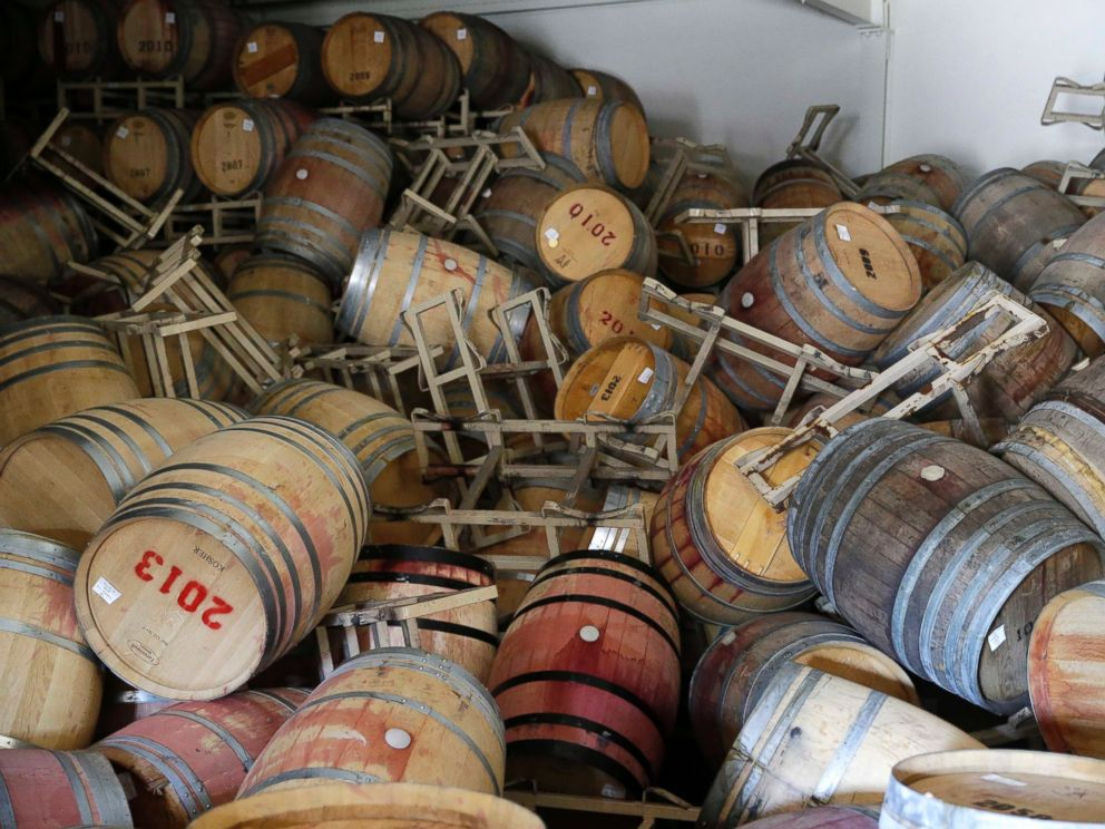 PHOTO: Barrels filled with Cabernet Sauvignon are toppled on one another following an earthquake at the B.R. Cohn Winery barrel storage facility, Aug. 24, 2014, in Napa, Calif.