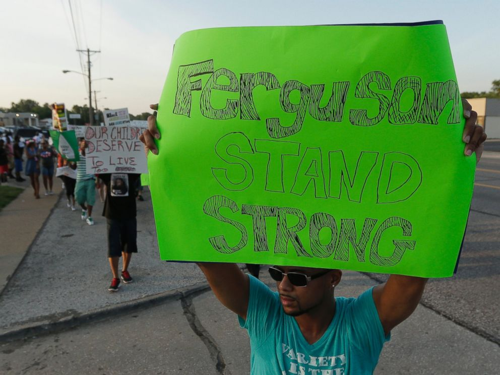PHOTO: People march to protest the shooting of Michael Brown, Aug. 20, 2014, in Ferguson, Mo.