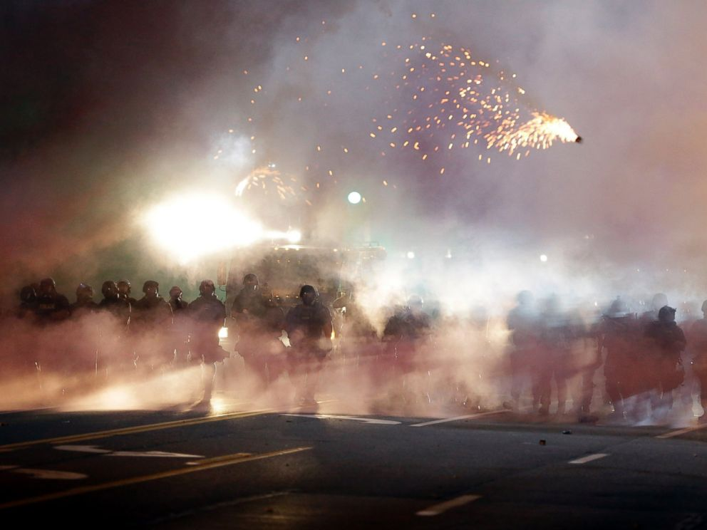 PHOTO: An explosive device deployed by police flies in the air as police and protesters clash, Aug. 13, 2014, in Ferguson, Mo.