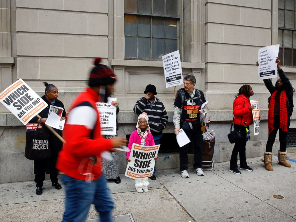 PHOTO: A group of protesters stand outside a courthouse as jury deliberations continue for the trial of Officer William Porter, one of six Baltimore city police officers charged in connection to the death of Freddie Gray, Dec. 16, 2015, in Baltimore.