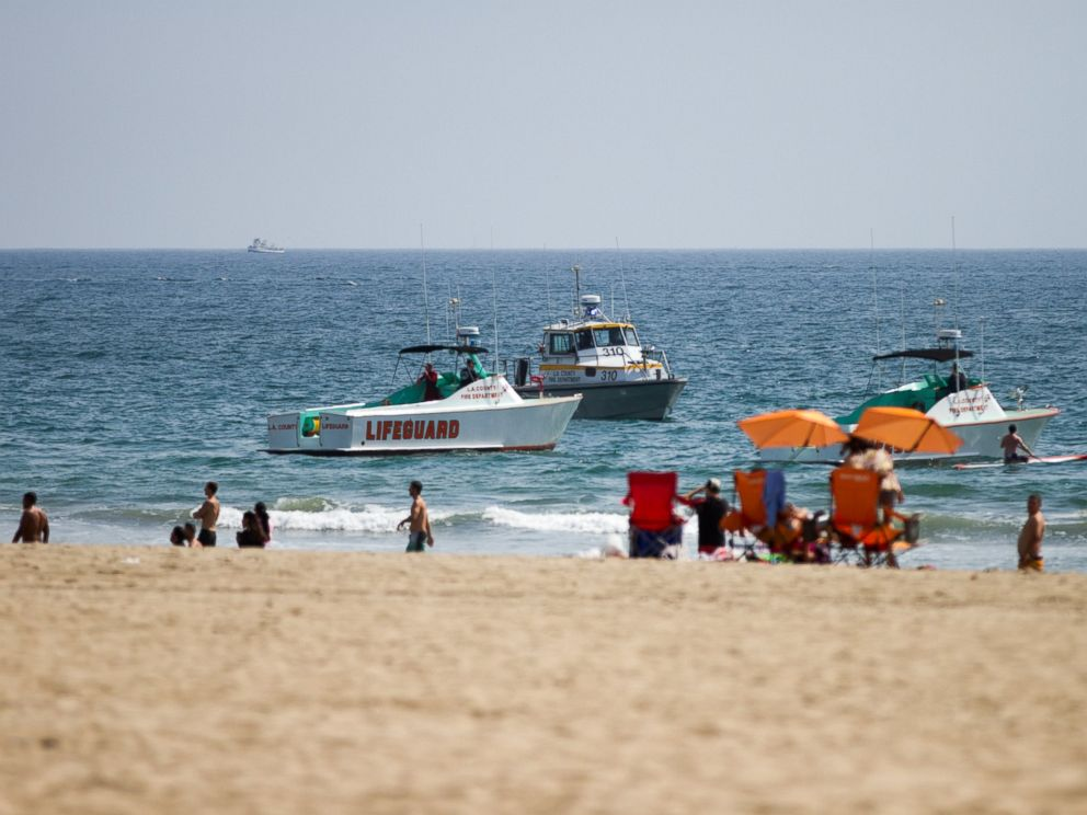 PHOTO: Lifeguard rescue boats patrol off the shore at Venice Beach, July 27, 2014 in Los Angeles, following a lightning strike.