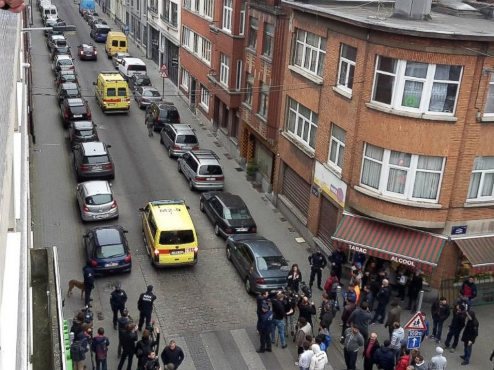 PHOTO: Emergency vehicles travel along a street blocked by armed police officers during a raid in the Molenbeek neighborhood of Brussels, Belgium, March 18, 2016.