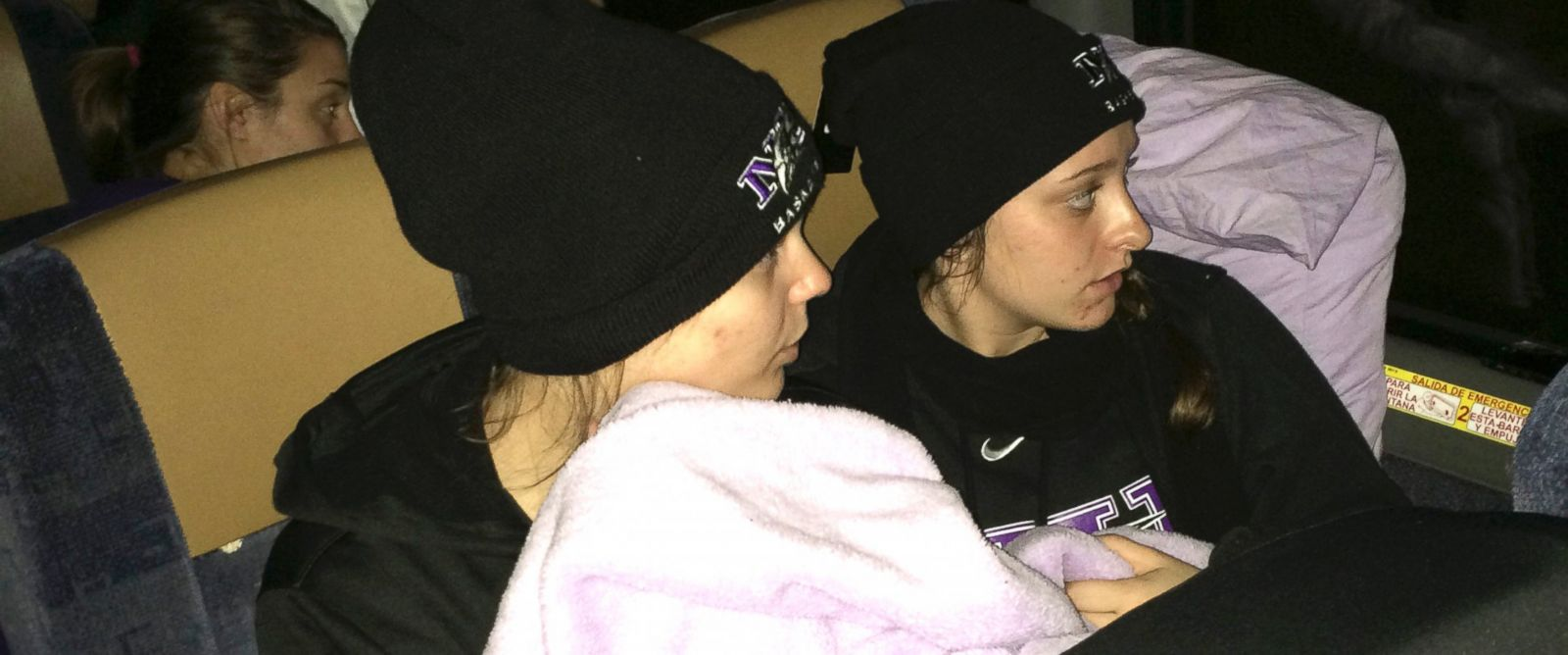 PHOTO: In this photo provided by Niagaras Tiffany Corselli, teammates Gabby Baldasare and Jamie Sherburne huddle under a blanket while stuck on a bus near Buffalo, N.Y., Nov. 18, 2014.
