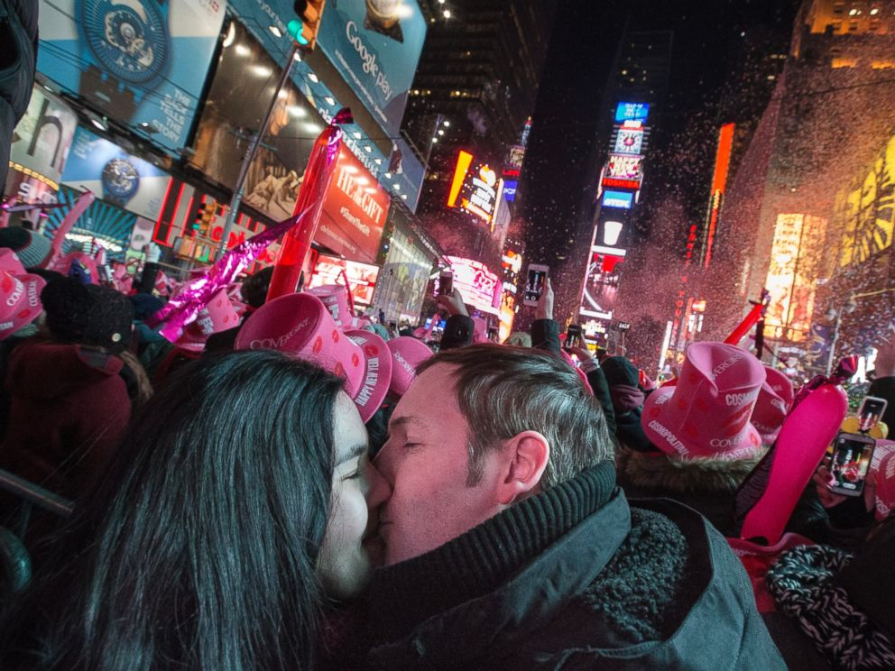 Chris and Chelsea Crawford, of Scotland, share a kiss at midnight in Times Square during a New Years Eve celebration, Thursday, Jan. 1, 2015, in New York. Thousands braved the cold to watch the annual ball drop and ring in the new year.