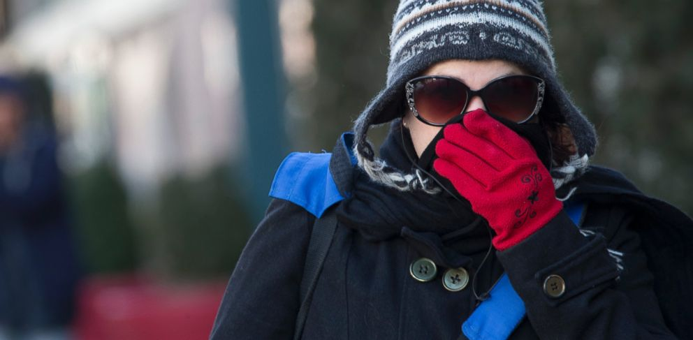 PHOTO: A woman lifts her scarf up in front of her nose to shield from the cold air, Friday, Feb. 12, 2016, in New York.