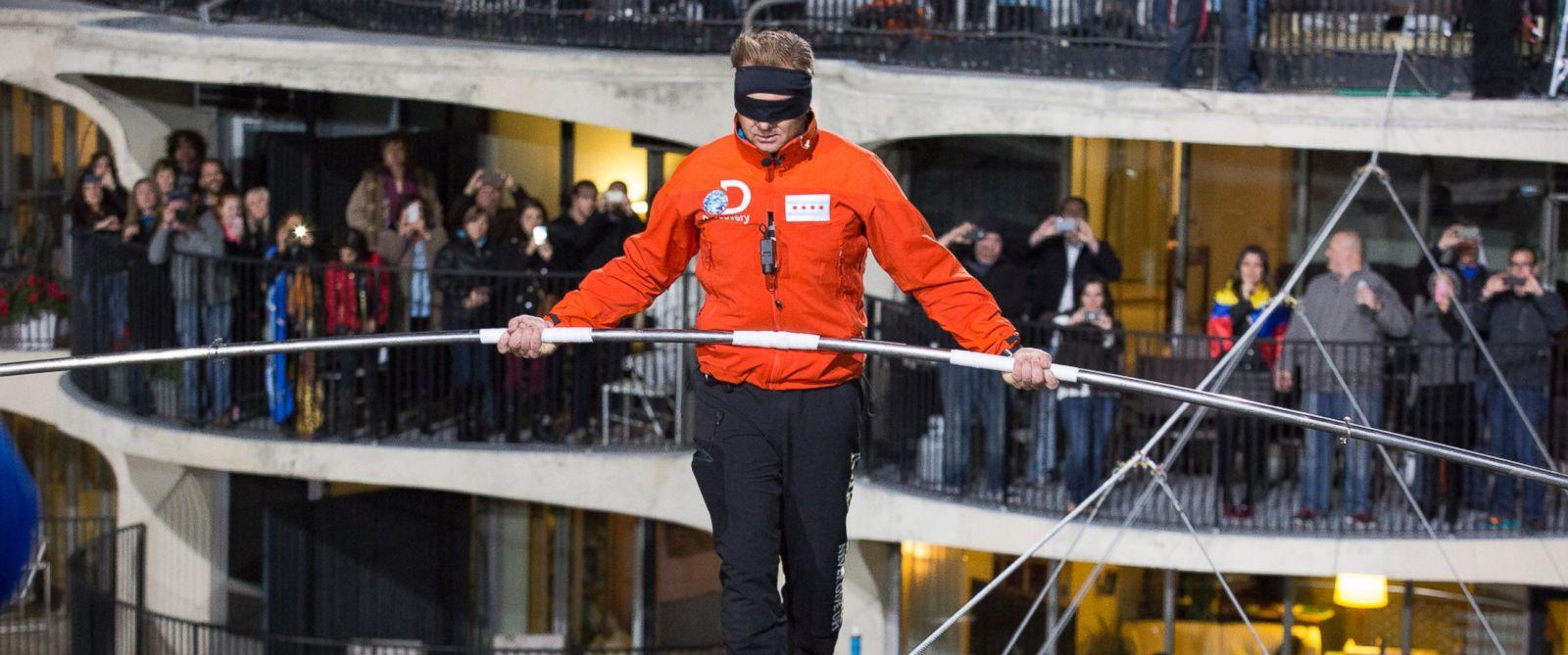 PHOTO: Nik Wallenda walks across the Chicago skyline blindfolded for Discovery Channels Skyscraper Live with Nik Wallenda, Nov. 2, 2014.