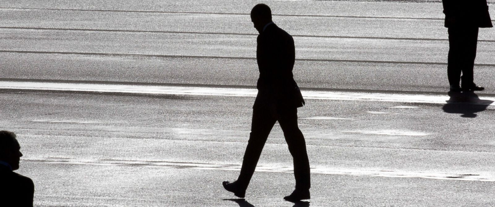 PHOTO: President Barack Obama, center, and two secret service agents are silhouetted as he walks towards Marine One helicopter upon arrival at Schiphol Amsterdam Airport, Netherlands, March 24, 2014.
