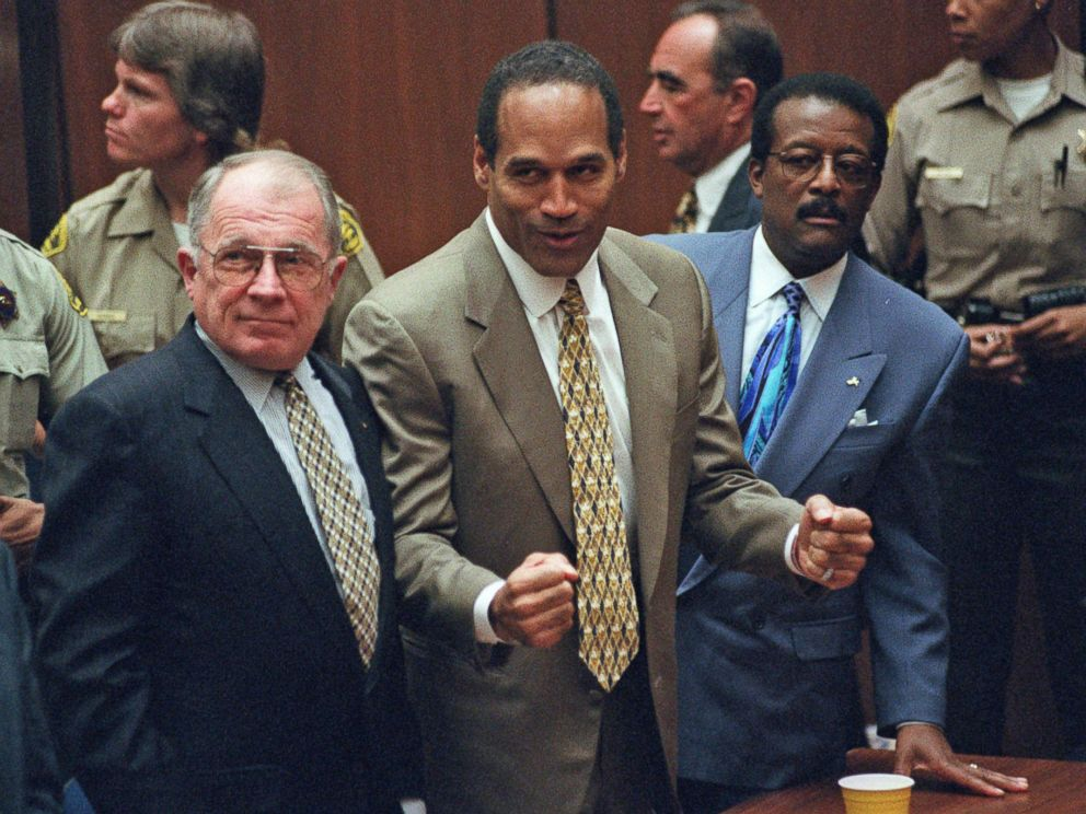 PHOTO: O.J. Simpson, center, reacts as he is found not guilty of murdering his ex-wife Nicole Brown and her friend Ron Goldman in court in Los Angeles, Oct. 3, 1995.