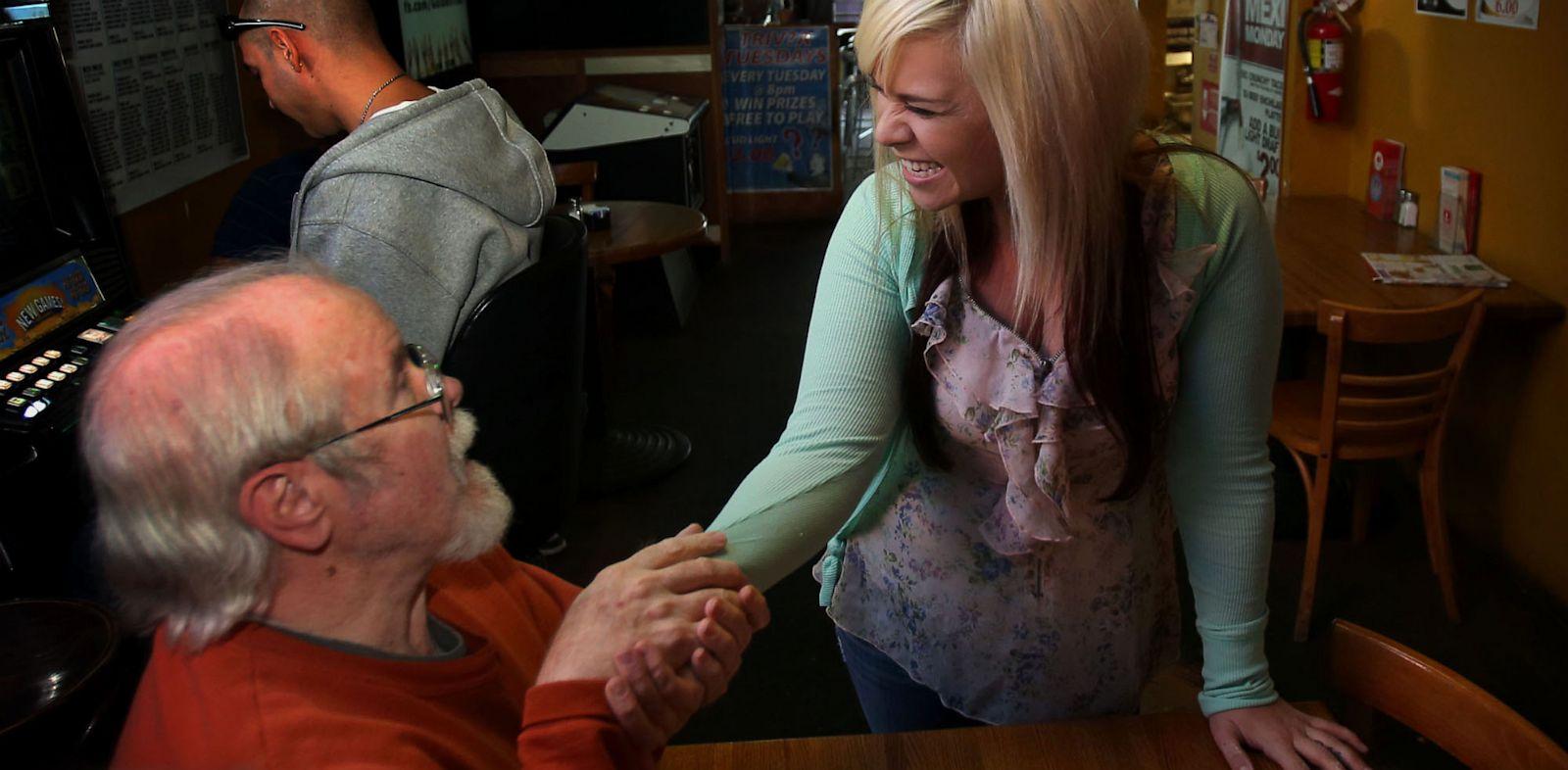 PHOTO: Bartender Aurora Kephart receives winning lottery ticket worth $17,500