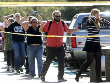 PHOTO: Students, staff and faculty are evacuated from Umpqua Community College in Roseburg, Ore. after a deadly shooting Thursday, Oct. 1, 2015.