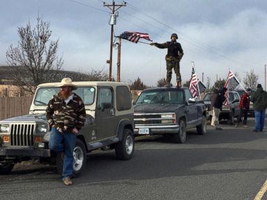 PHOTO: People wave American flags near the Malheur National Wildlife Refuge, Feb. 11, 2016, near Burns, Ore.