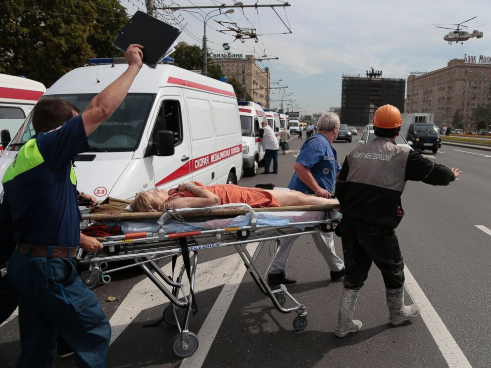 PHOTO: Paramedics carry an injured woman out from a subway station after a rush-hour subway train derailment, to be transported by a medical helicopter in Moscow, Russia, on Tuesday, July 15, 2014.