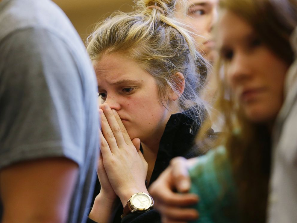 PHOTO: A woman prays at a service at the First Free Methodist Church, June 5, 2014, following a shooting at Seattle Pacific University.