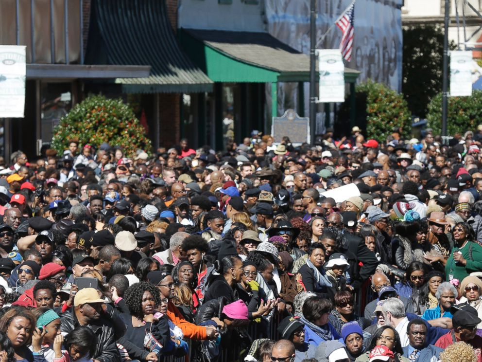 A large crowd forms near a stage where President Barack Obama will speak and then take a symbolic walk across the Edmund Pettus Bridge, Saturday, March 7, 2015, in Selma, Ala. This weekend marks the 50th anniversary of Bloody Sunday.