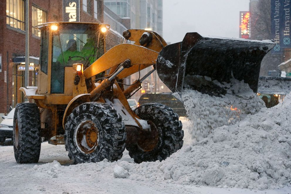 PHOTO: A front end loader clears snow from the street near Fenway Park in Boston, Saturday, Feb. 14, 2015.