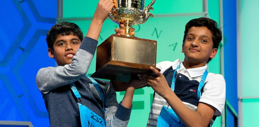 PHOTO: Nihar Janga, 11, of Austin, Texas, and Jairam Hathwar, 13, of Painted Post, N.Y., hold up the trophy after being named co-champions at the 2016 National Spelling Bee, in National Harbor, Md., on May 26, 2016.