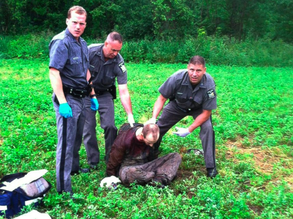 PHOTO: Police stand over David Sweat after he was shot and captured near the Canadian border Sunday, June 28, 2015, in Constable, N.Y.