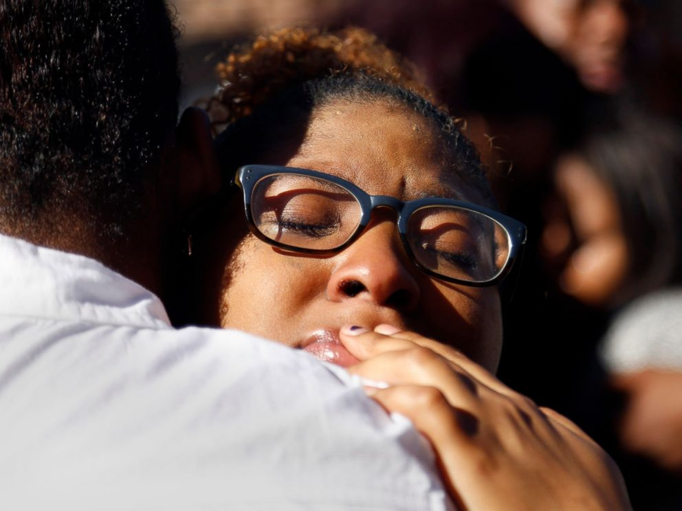 PHOTO: A member of Concerned Student 1950 hugs a fellow protestor after the group prayed together in front of the Reynolds Alumni Center on the University of Missouri campus in Columbia, Mo. on Nov. 7, 2015.