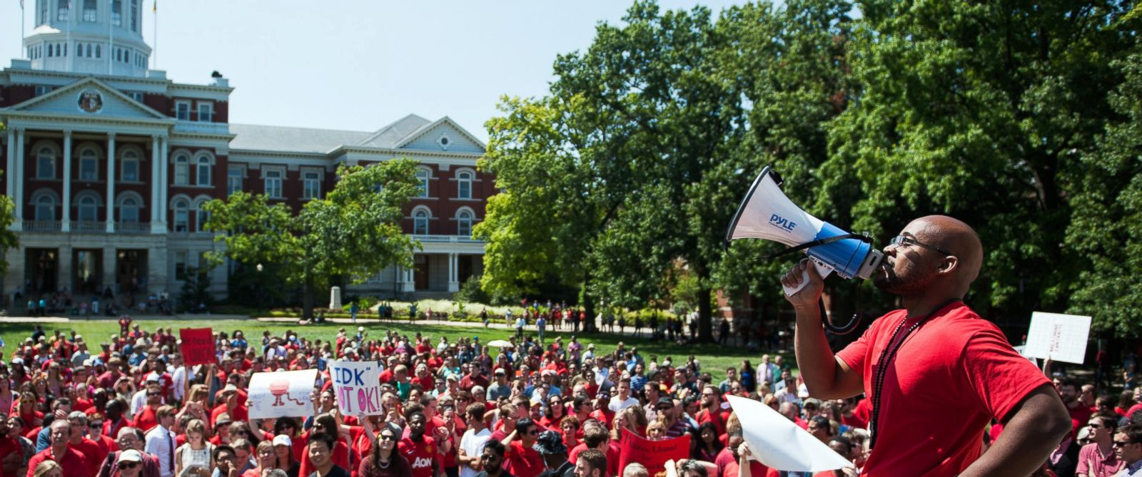 """PHOTO: Jonathan Butler uses a megaphone to encourage others to chant during a """"day of action"""" demonstration celebrating graduate students on the University of Missouri campus in Columbia, Mo. on Aug. 26, 2015."""