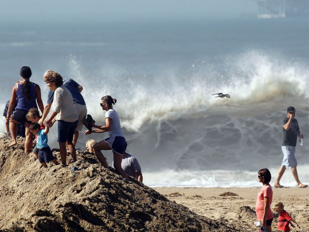 PHOTO: Onlookers watch as big waves come into shore from Hurricane Marie in Seal Beach, Calif., Aug. 27, 2014.