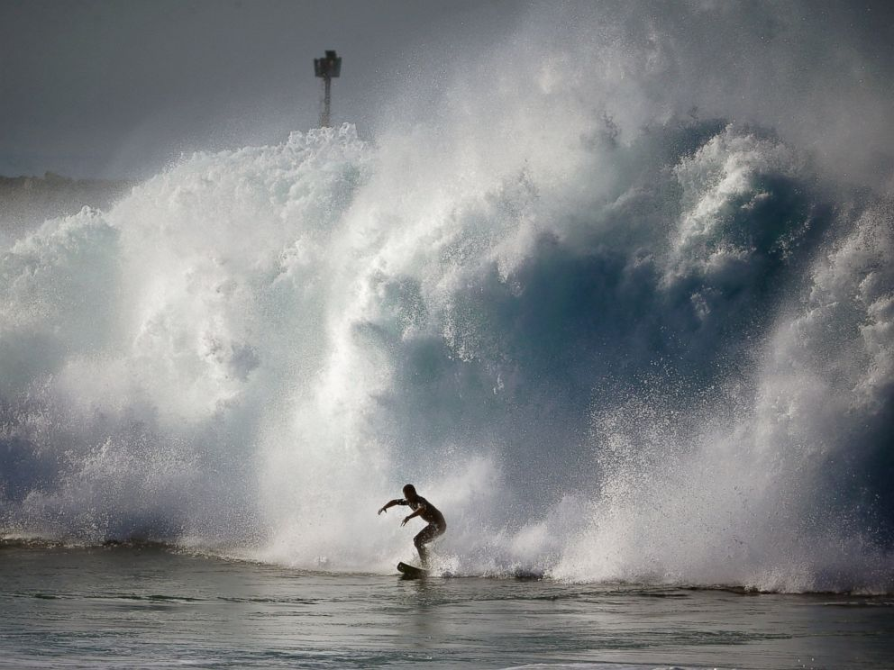 PHOTO: A surfer rides a wave at the wedge in Newport Beach, Calif., Aug. 27, 2014.