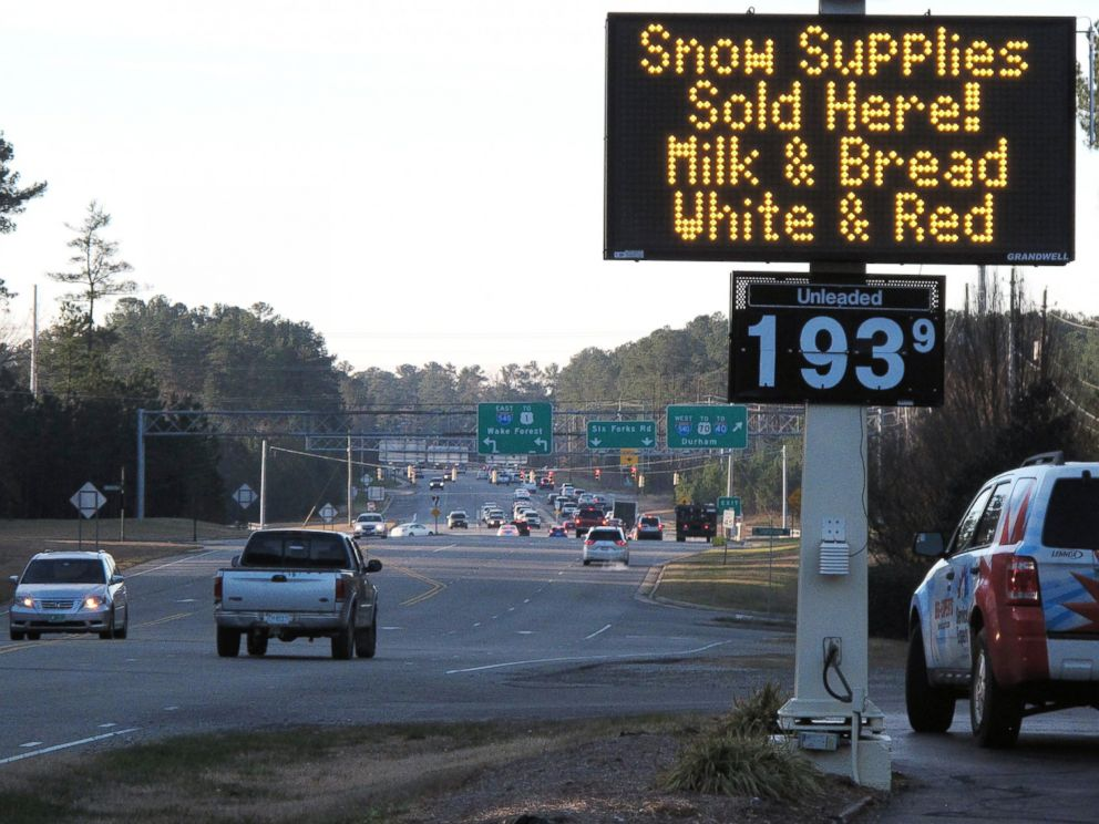 PHOTO: A convenience store in Raleigh, N.C., advertises the essentials as a winter storm threatens to dump the first big snow of the season Jan. 21, 2016.